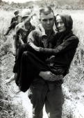 August 1965 Ba Ria South Vietnam An aged and frail Vietnamese woman is carried to safety by an American soldier