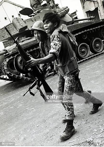 February 1968 Vo Duy Nguy South Vietnam A South Vietnamese soldier shouting angrily helps away a wounded comrade after a confrontation with the Viet...
