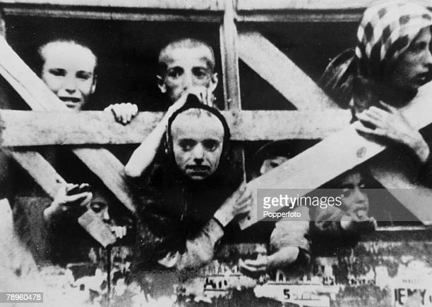 circa 1943 Children peer from a barred goods wagon as the train is about to transport them to an uncertain future many children ended up in the Nazi...
