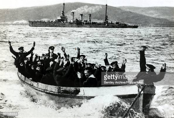 21st June 1919 The German Fleet scuttled at Scapa Flow German sailors in a boat approaching the shore after their ship the 'Nurnberg' had been...