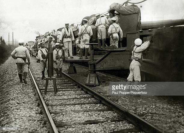 War and Conflict World War I pic1918 An Italian armoured train preparing to fire it's guns the officer carrying the hammer will bang the gong for the...