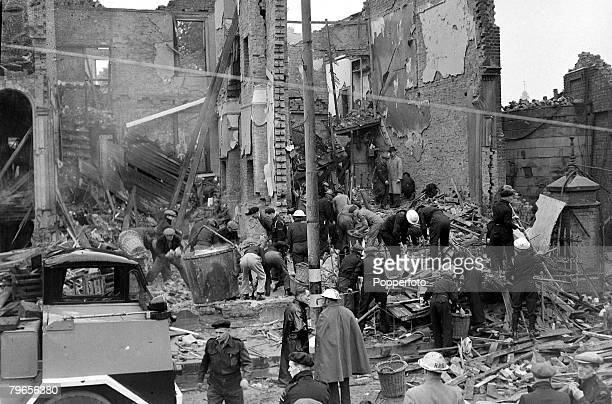 13th June 1944 Rescue workers searching bombed shops in East London after a German bombing raid