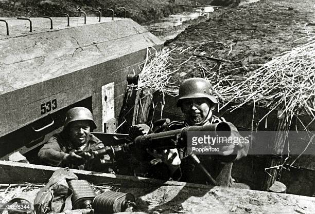 May 1940 German soldiers clear a Dutch bunker of it's weapons after taking control in Holland Germany invaded Belgium Holland and Luxembourg in May...