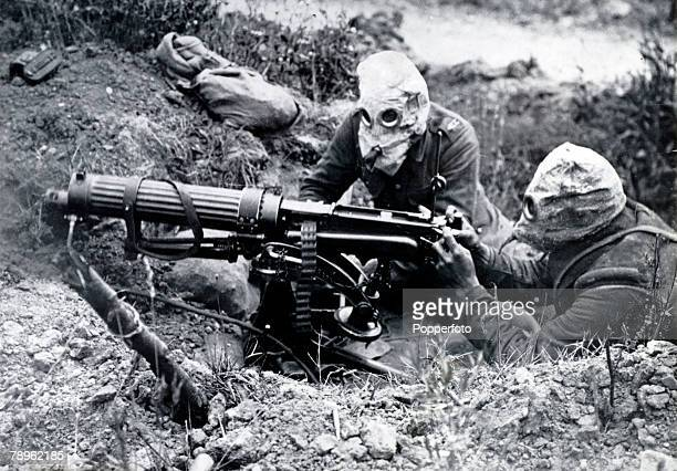 July 1916 Ovillers Battle of the Somme British soldiers with a Vickers machine gun as they wear PH helmets as protection against gas attack which...