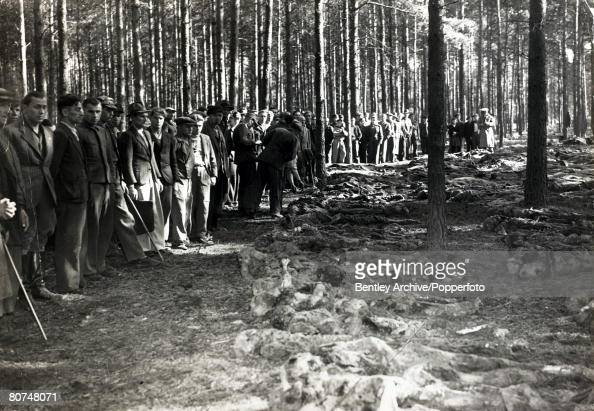 War and Conflict World War Two Atrocities pic September 1945 Local German's are brought to the area where an atrocity took place discovered in a wood...