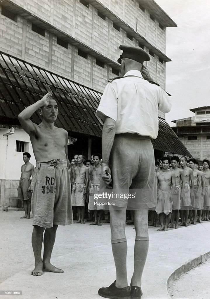 War and Conflict, World War Two, Far East, pic: circa 1946, Japanese Lieutenant-General Renya Mutaguchi pictured in baggy shorts, with his men behind, salutes the military Governor of Changhi Jail, Singapore Major Tim Heal, Mutaguchi awaits trial suspected of war crimes