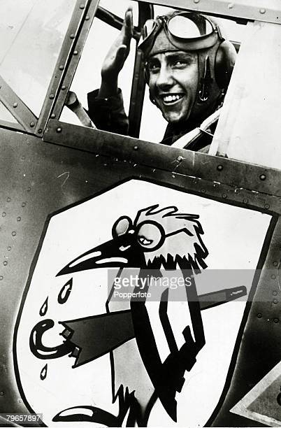 circa 1940 Propaganda A German pilot in his plane which shows a caricature supposed to be British Prime Minister Neville Chamberlain with his umbrella