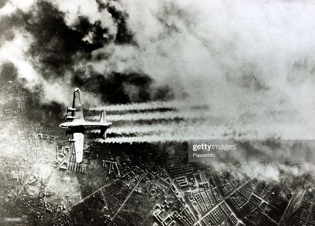 February 1945, An American B-17 'Flying Fortress' pictured making a daylight raid over Berlin, with the sky full of smoke