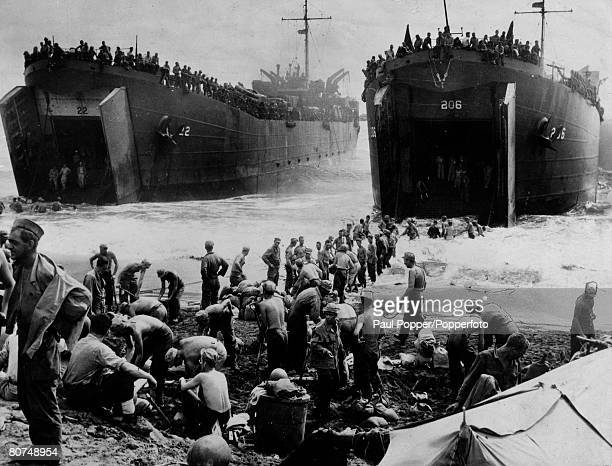 March 1945 American forces unloading stores from huge landing craft on the island of Leyte in the Philippines