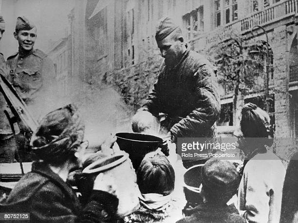 May 1945 Russian soldiers handing out food to hungry people after the fall of Berlin and the German surrender