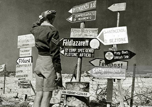 November 1942 The retraeting Axis forces having pulled out of Mersa Matruh Egypt leave behing a mass of signs in German and Italia which perplexes...