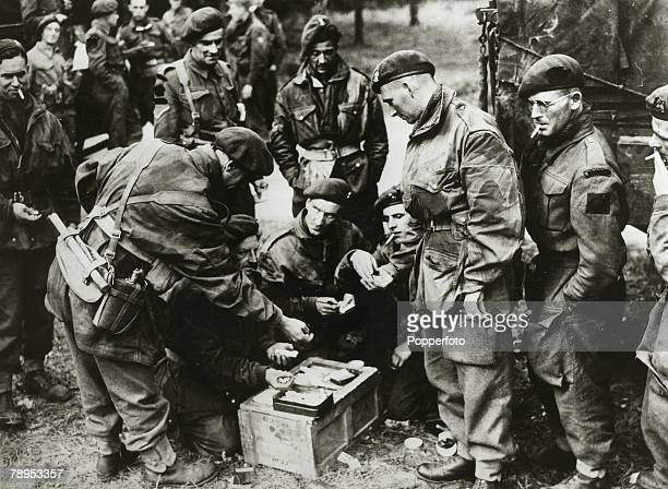 September 1944 British soldiers drawing cigarette and chocolate rations at the roadside during the Arnhem operations in Holland