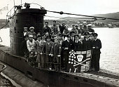 War and Conflict World War Two Royal Navy pic circa 1942 The British submarine 'Ultor' and it's crew display the 'Jolly Roger' showing the kills the...