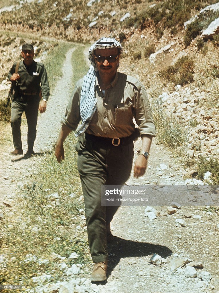 War & Conflict, Personalities, Middle East, PLO and Al Fatah leader Yasser Arafat pictured on a road during a visit to Al Fatah positions in Jordan in May 1968.