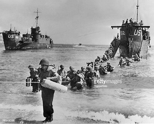 War Conflict World War Two France August 1944 American troops and their equipment disembark from US Navy landing craft onto a beach east of Toulon...