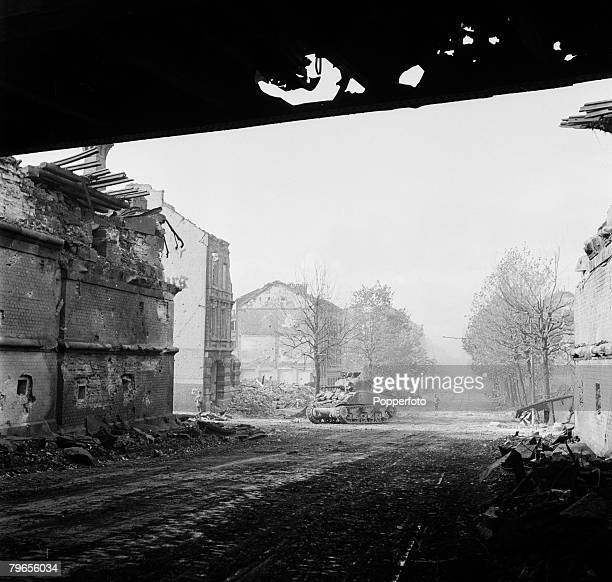 War Conflict World War Two Germany 15th October 1944 American army tanks and infantry moving through the shattered streets of Aachen
