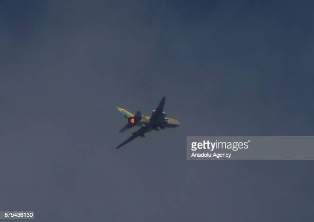 A war craft belonging to Assad regime's army carries out airstrikes over residential areas of Arbin town of the Eastern Ghouta region of Damascus in...