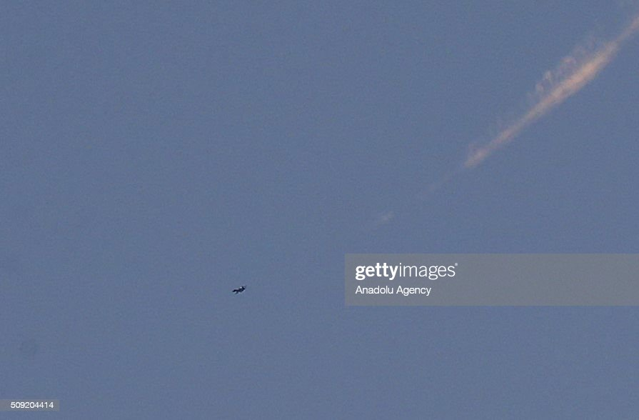 A war craft belonging to the Russian Army carries out airstrikes on the residential areas near a tent city close to the Bab al-Salam crossing, opposite the Turkish province of Kilis, in Azaz town of Aleppo, Syria on February 9, 2016.