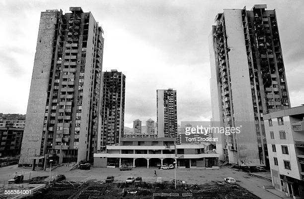 War damaged high rise apartment blocks in Sarajevo The area was known as Heroes Square because of the intense fighting and shelling which made it...