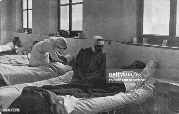 War Hospital in the ward Postcard produced for the benefit of the Italian Red Cross is entitled 'also in trench were neighbors' Photo engraving...