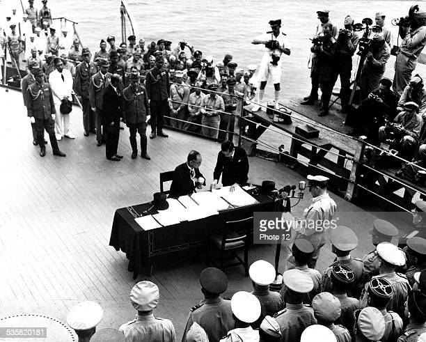 War in the Pacific Japanese minister of Foreign Affairs signing the surrender of Japan In front of him General Mac Arthur September 2 Japan World War...
