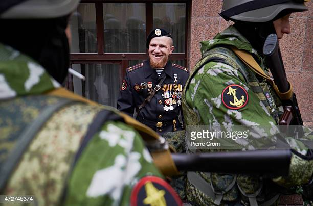 A war lord called Motorola takes part in a military parade as as residents of Donetsk celebrate VE Day on May 9 2015 in Donetsk Ukraine Ceremonies...