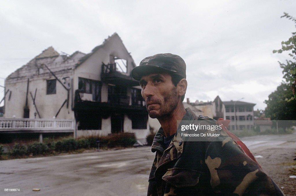 War of BosniaHerzegovina Bosnian soldier in front of a house in ruins Dobosnica September 1992