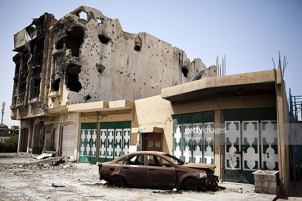War ravaged buildings pockmarked with mortar and bullet holes, are abandoned on Tripoli street on September 3 2011 in Misrata, Libya.