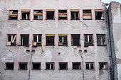 cracked windows on a Belgrade building