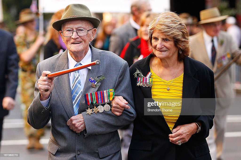 A war veteran and his relative make their way down Bathurst Street during the ANZAC Day parade on April 25, 2013 in Sydney, Australia. Veterans, dignitaries and members of the public today marked the 98th anniversary of ANZAC (Australia New Zealand Army Corps) Day, April 25, 1915 when allied First World War forces landed on the Gallipoli Peninsula. A public holiday in both Australia and New Zealand, commemoration events are held across both countries in remembrance of those who fought and died in all wars.