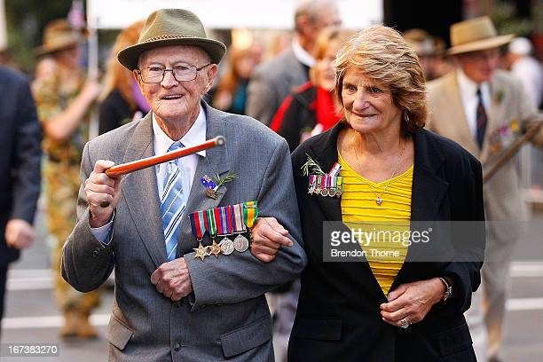 A war veteran and his relative make their way down Bathurst Street during the ANZAC Day parade on April 25 2013 in Sydney Australia Veterans...