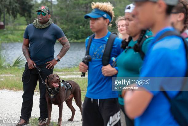 War veteran Chad Brown and his service dog Axe look on during an activity at the Arthur R Marshall Loxahatchee National Wildlife Refugee in Boynton...