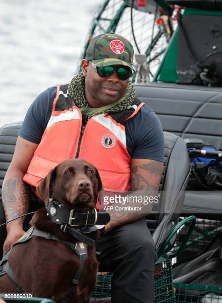 War veteran Chad Brown and his service dog Axe ride through the Everglades during an airboat tour at the Arthur R Marshall Loxahatchee National...