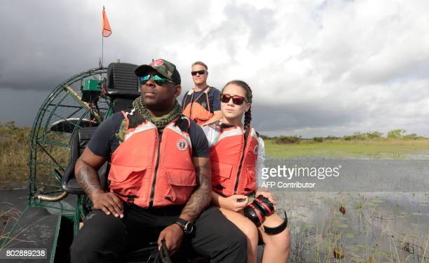 War veteran Chad Brown and Riley Brooks ride through the Everglades during an airboat tour at the Arthur R Marshall Loxahatchee National Wildlife...