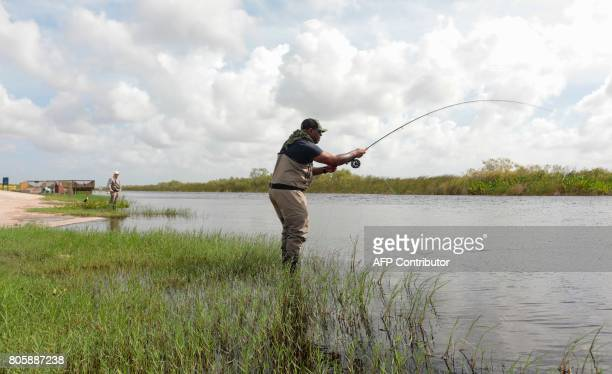 War veteran Chad Brown casts a line while relaxing at the Arthur R Marshall Loxahatchee National Wildlife Refugee in Boynton Beach Florida on June 19...