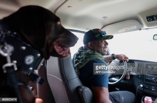 War veteran Chad Brown drives with his service dog Axe at the Arthur R Marshall Loxahatchee National Wildlife Refugee in Boynton Beach Florida on...