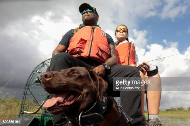 War veteran Chad Brown his dog Axe and Riley Brooks ride through the Everglades during an airboat tour at the Arthur R Marshall Loxahatchee National...