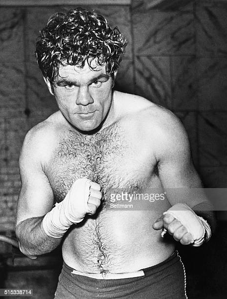 War veteran Freddie Mills British Heavyweight Champion is back in the gymnasium to regain his ring form He's scheduled to perform in the United States