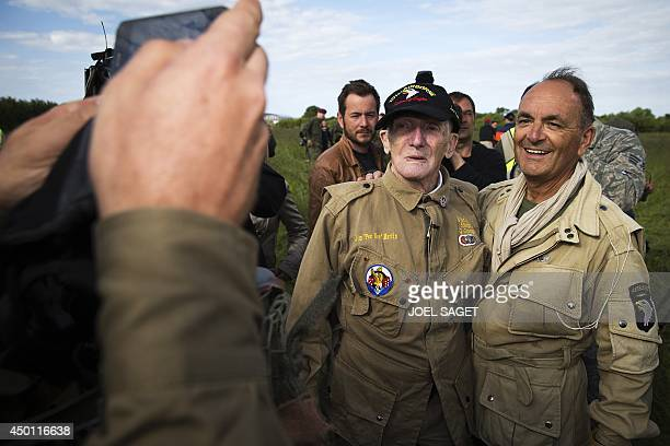 US war veteran Jim 'Pee Wee' Martin poses for a picture after landing with a parachute on June 5 2014 in Carentan where he landed 70 years ago when...