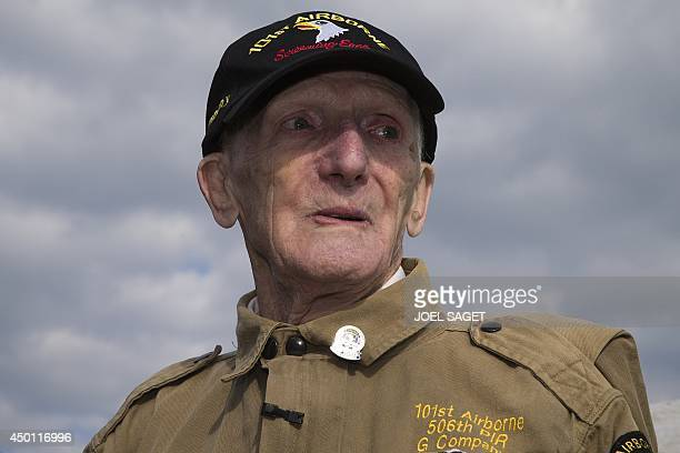 US war veteran Jim 'Pee Wee' Martin reacts after a parachute tandem jump on June 5 2014 in Carentan Normandy where he landed 70 years ago when he was...