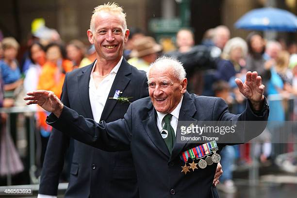 A war veteran makes his way down Bathurst Street during the ANZAC Day parade on April 25 2014 in Sydney Australia Veterans dignitaries and members of...