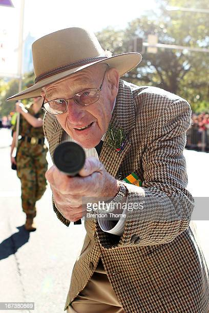 A war veteran makes his way down Elizabeth Street during the ANZAC Day parade on April 25 2013 in Sydney Australia Veterans dignitaries and members...