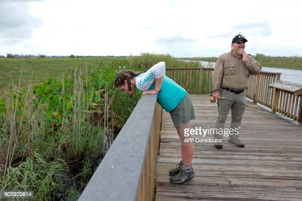 War veteran Terry Edelman and Riley Brooks explore a board walk at the Arthur R Marshall Loxahatchee National Wildlife Refugee in Boynton Beach...