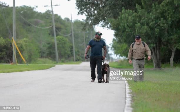 War veterans Chad Brown and Terry Edelman walk at the Arthur R Marshall Loxahatchee National Wildlife Refugee in Boynton Beach Florida on June 19...