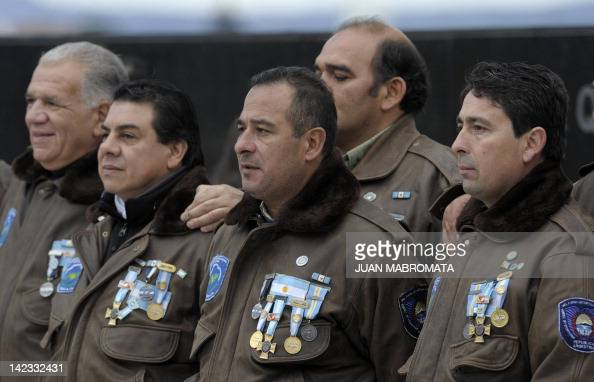 War veterans pose for a pictures displaying their medals during a ceremony to mark the 30th Anniversary of the 1982 South Atlantic war between...