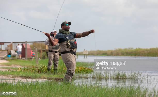 War veterans Terry Edelman and Chad Brown fishe at the Arthur R Marshall Loxahatchee National Wildlife Refugee in Boynton Beach Florida on June 19...