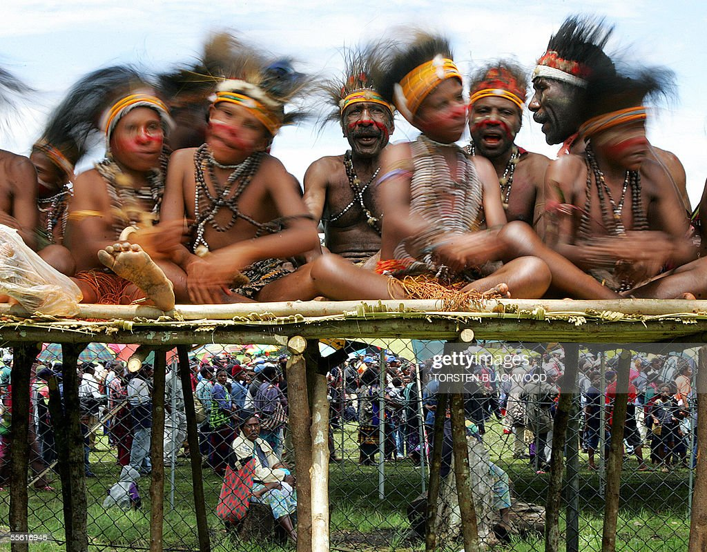 Wara Sua boys from Simbu gyrate their heads during the Goroka singsing in the Southern Highlands 16 September 2005 Over 60 tribes from all over Papua...