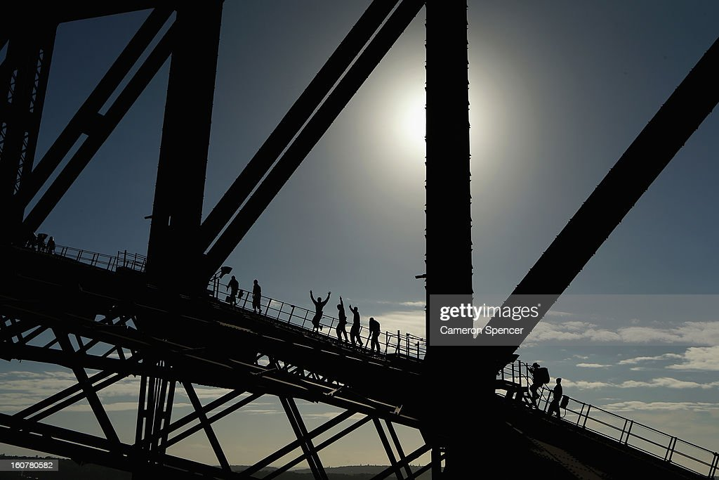 Waratah players climb the Sydney Harbour Bridge during a Waratahs promotional event during their season launch on February 6, 2013 in Sydney, Australia.