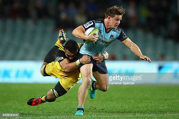 Waratahs captain Michael Hooper is tackled during the round 16 Super Rugby match between the Waratahs and the Hurricanes at Allianz Stadium on July 9...