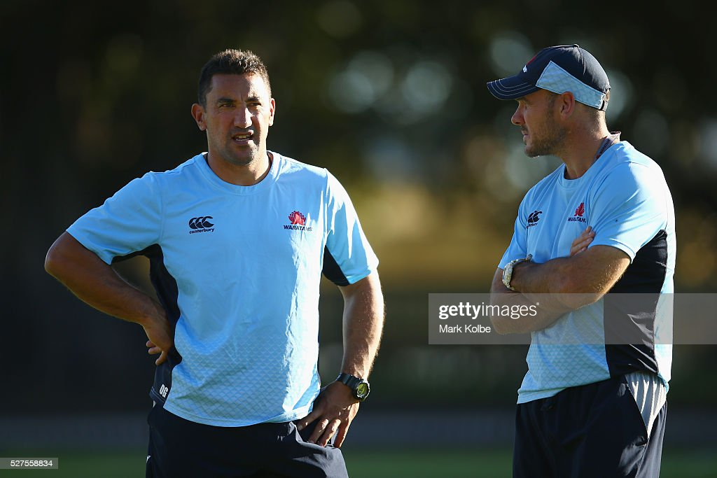 Waratahs coach Daryl Gibson speaks to assistant coach Nathan Grey during a Waratahs Super Rugby training session at Kippax Lake on May 3, 2016 in Sydney, Australia.